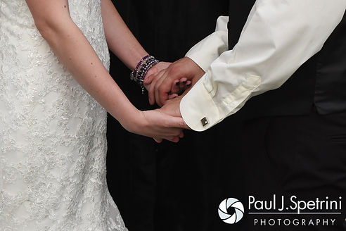 Jen and Kyle hold hands during their September 2016 wedding at the Roger Williams Park Botanical Center in Providence, Rhode Island.