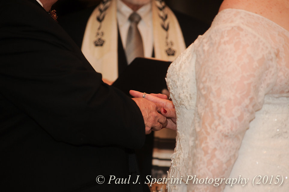 Ron and Cathy exchange rings during their December 2015 Rhode Island wedding at Quidnessett Country Club in North Kingstown, RI.