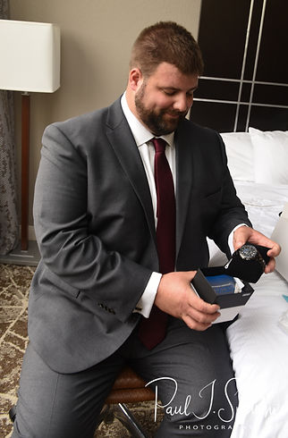 Steve opens a gift from Katie prior to his October 2018 wedding ceremony at The Villa at Ridder Country Club in East Bridgewater, Massachusetts.