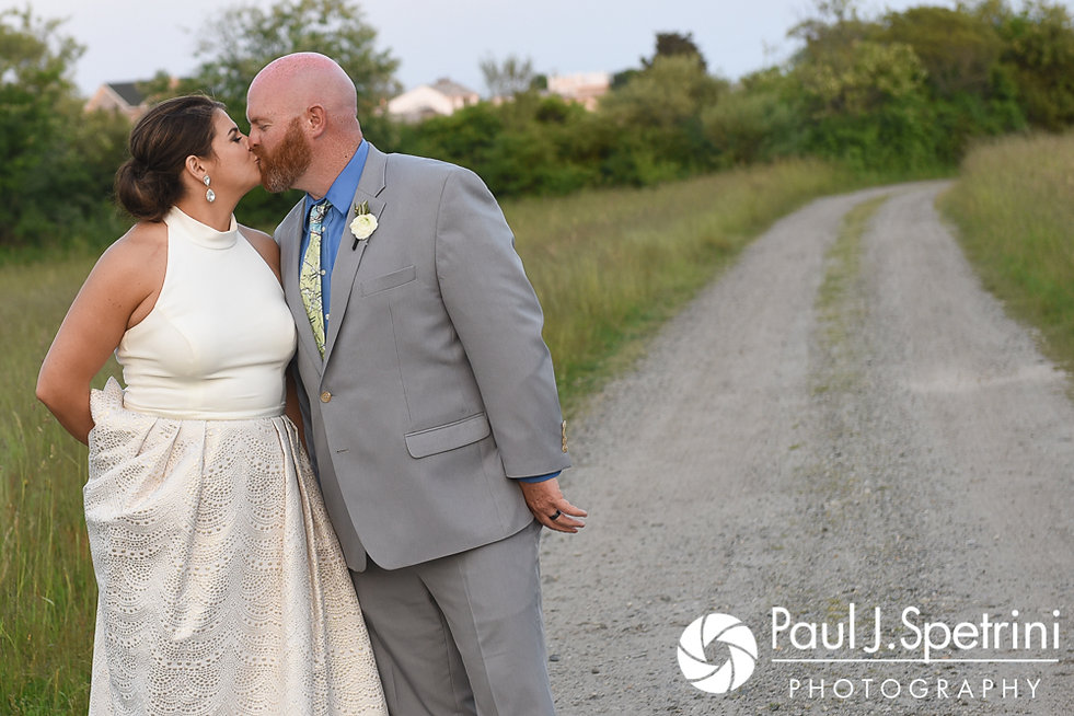 Molly and Tim kiss for a formal photo during their June 2017 wedding reception at Farmhouse-By-The-Sea in Matunuck, Rhode Island.