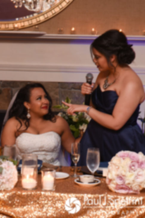 Stephany's maid of honor gives a toast during Stephany and Arten's September 2017 wedding reception at Wannamoisett Country Club in Rumford, Rhode Island.