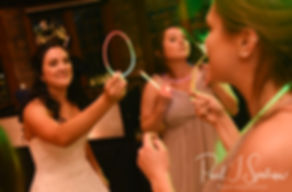 Nicole and guests dance during her September 2018 wedding reception at The Towers in Narragansett, Rhode Island.