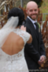 Mike turns around for a first look at his bride Emma prior to their November 2015 wedding at the Publick House in Sturbridge, Massachusetts.