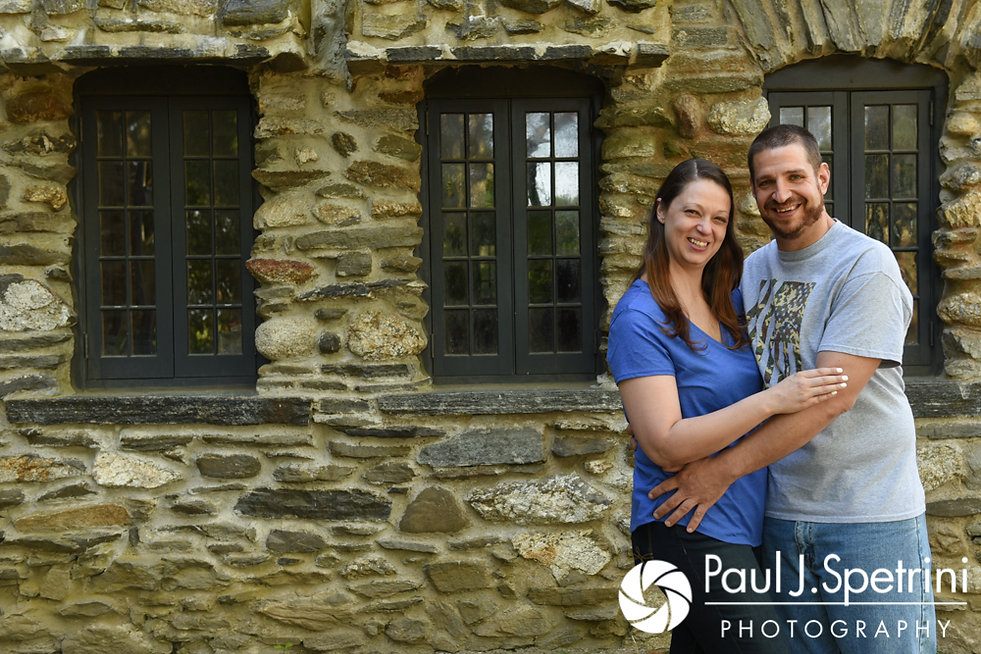 Jennifer and Kevin pose for a photo in front of a castle during their May 2017 engagement session at Gillette Castle State Park in East Haddam, Connecticut.