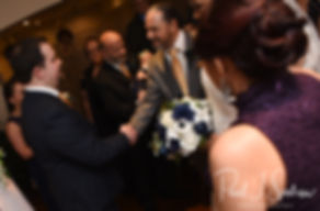 Gunnar shakes hands with Aileen's dad during his December 2018 wedding ceremony at McGoverns on the Water in Fall River, Massachusetts.