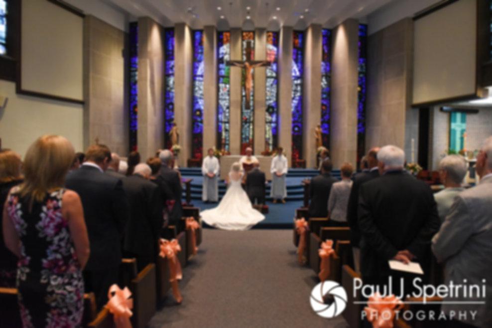Tricia and Kevin listen to their priest speak during their October 2017 wedding ceremony at St. Brendan Parish in Riverside, Rhode Island.
