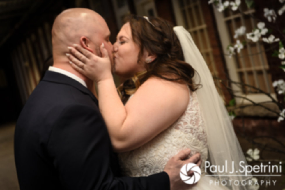Meridith and Matthew share their first kiss as husband and wife during their May 2017 wedding ceremony at the Hope Artiste Village in Pawtucket, Rhode Island.