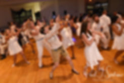 Guests dance during Mike & Selah's August 2018 wedding reception at The Rotunda Ballroom at Easton's Beach in Newport, Rhode Island.