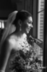 Kendra looks outside prior to her May 2018 wedding ceremony at Crystal Lake Golf Club in Mapleville, Rhode Island.