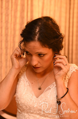 Amanda puts on her earrings prior to her October 2018 wedding ceremony at the Walt Disney World Swan & Dolphin Resort in Lake Buena Vista, Florida.