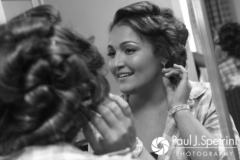 Toni puts on her earrings prior to her August 2017 wedding ceremony at Crystal Lake Golf Club in Mapleville, Rhode Island.