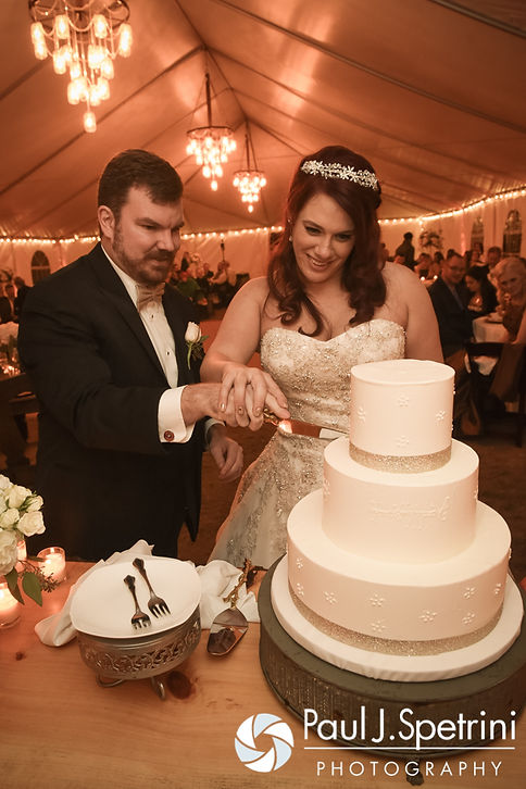 JD and Brooke cut the cake during their October 2016 wedding reception at The Farm at SummitWynds in Jefferson, Massachusetts.