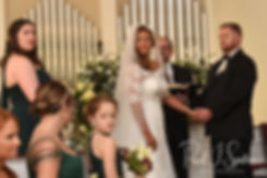 Cara and Brandon look on as Cara's mom speaks during their November 2018 wedding ceremony at First Baptist Church in Hope Valley, Rhode Island.