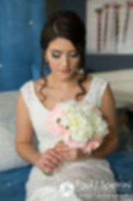 Maria looks down at her flowers for a bridal portrait prior to her March 2016 Rhode Island wedding.