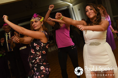 Stephanie dances with guests during her October 2016 wedding reception at Lake Pearl Luciano's in Wrentham, Massachusetts.