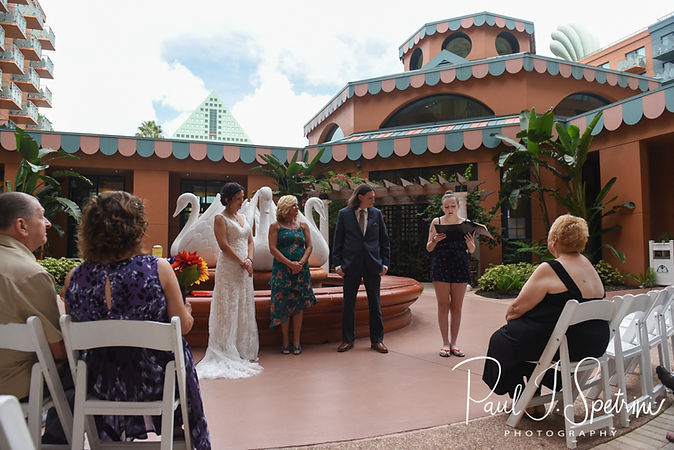 A family member reads a passage during Amanda & Josh's October 2018 wedding ceremony at the Walt Disney World Swan & Dolphin Resort in Lake Buena Vista, Florida.