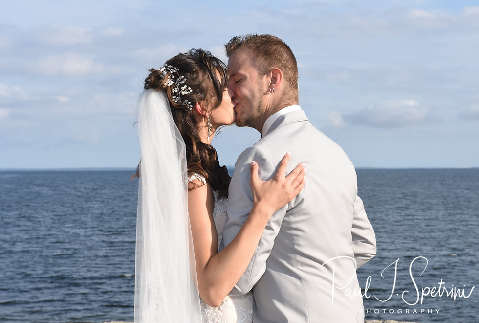 Beth and Bryan kiss during their August 2018 wedding ceremony at Fort Phoenix in Fairhaven, Massachusetts.