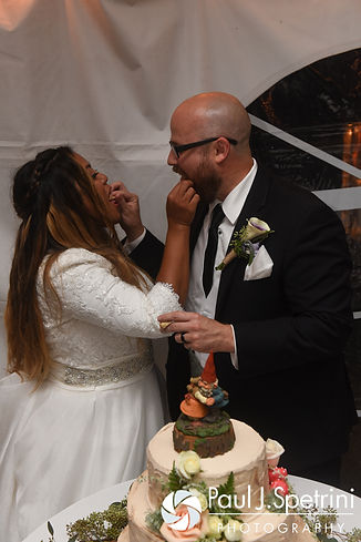 Forrester and Lisajean feed eat other cake during their October 2016 wedding reception in Charlestown, Rhode Island.