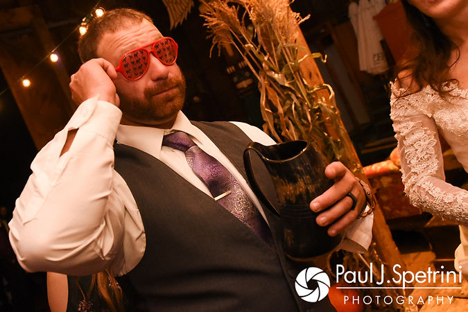 Dale puts on a pair of decorative glasses during his October 2017 wedding reception at the Golden Lamb Buttery in Brooklyn, Connecticut.
