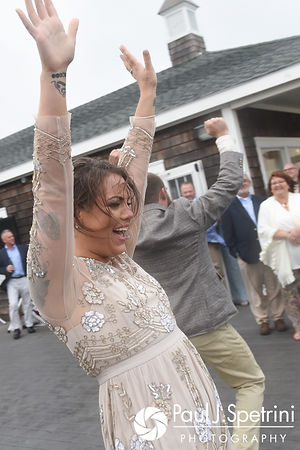Arielle celebrates during her September 2017 wedding reception at North Beach Club House in Narragansett, Rhode Island.