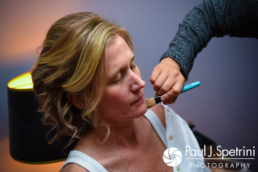 Tricia has her makeup applied prior to her October 2017 wedding ceremony at St. Brendan Parish in Riverside, Rhode Island.