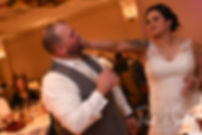 Justine smashes a piece of cake in Jon's face during their October 2018 wedding reception at Twelve Acres in Smithfield, Rhode Island.
