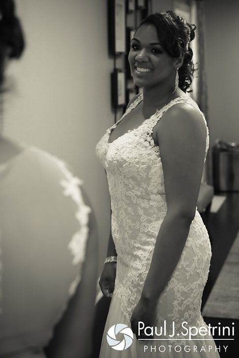 Kemi looks herself over in the mirror prior to her August 2016 wedding reception at the Villa at Riddler Country Club in East Bridgewater, Massachusetts.