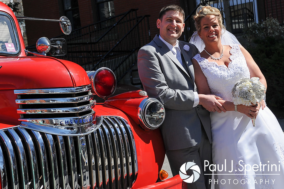 Angela and Shawn pose in front of the Kay Chapel in Newport, Rhode Island following their spring Rhode Island wedding.