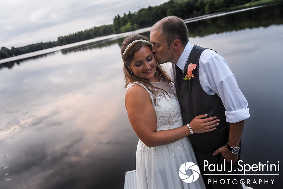 Toni and Scott pose for a photo on the dock during their August 2017 wedding reception at Crystal Lake Golf Club in Mapleville, Rhode Island.