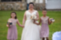 Ashley walks down the aisle with her daughters during her September 2018 wedding ceremony at Stepping Stone Ranch in West Greenwich, Rhode Island.