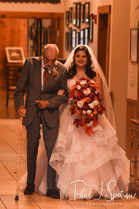 Makayla walks down the aisle with her uncle during her October 2018 wedding ceremony at Zukas Hilltop Barn in Spencer, Massachusetts.
