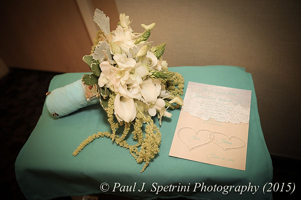 The flowers and invitation for the wedding of Joe and Jean Andrade.