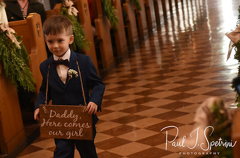 Stacey and Mack's son walks down the aisle during their December 2018 wedding ceremony at St. Teresa's Church in Attleboro, Massachusetts.