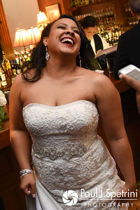 Stephany laughs during her September 2017 wedding reception at Wannamoisett Country Club in Rumford, Rhode Island.