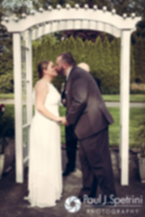 Latasha and Justin share their first kiss as husband and wife during their May 2016 wedding at Country Gardens in Rehoboth, Massachusetts.