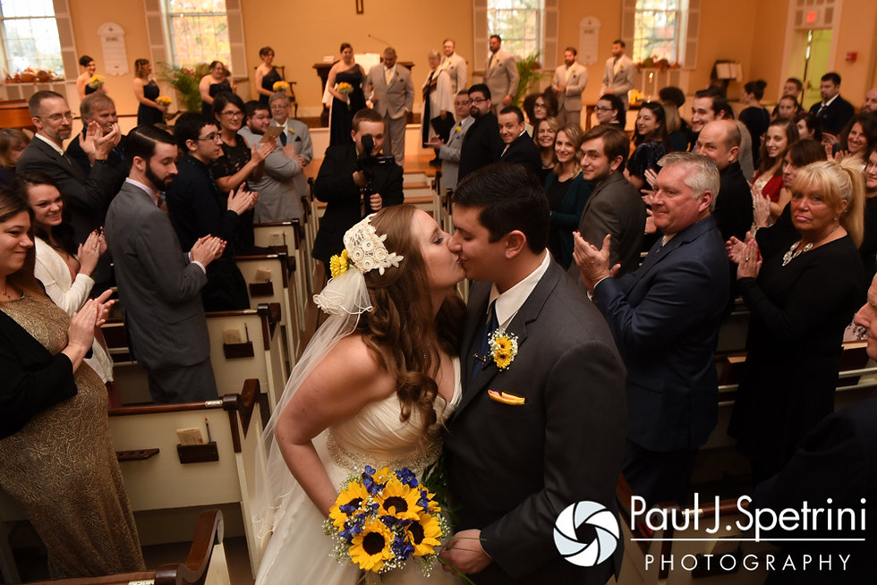 Kristin and Chris kiss during their October 2016 wedding ceremony at Exeter Congregational Church in Exeter, New Hampshire.