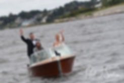 Meghan and Brian arrive by boat prior to their September 2018 wedding reception at Squantum Association in Riverside, Rhode Island.