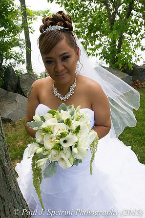 Jean Andrade poses for bridal portraits on the day of her wedding in Providence, Rhode Island.