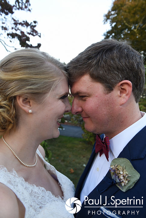 Mike and Rachel pose for a formal photo prior to their October 2017 wedding reception at Castle Manor Inn in Gloucester, Massachusetts.