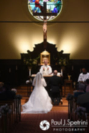 Forrester and Lisajean listen to their priest during their October 2016 wedding ceremony at St. Thomas More Church in Narragansett, Rhode Island.
