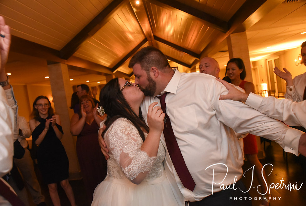 Katie and Steve kiss during their October 2018 wedding reception at The Villa at Ridder Country Club in East Bridgewater, Massachusetts.