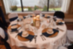 A look at the table settings during Gunnar & Aileen''s December 2018 wedding reception at McGoverns on the Water in Fall River, Massachusetts.