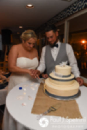 Jennifer and Robert cut the cake during their September 2017 wedding reception at Oceanside at the Pier in Narragansett, Rhode Island.