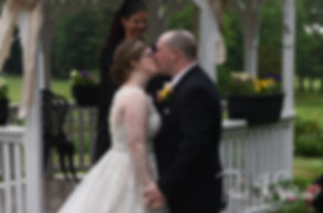 Zach and Kelly kiss during their June 2018 wedding ceremony at Blissful Meadows Golf Club in Uxbridge, Massachusetts.