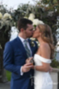 David and Whitney kiss following their October 2018 wedding ceremony at Castle Hill Inn in Newport, Rhode Island.