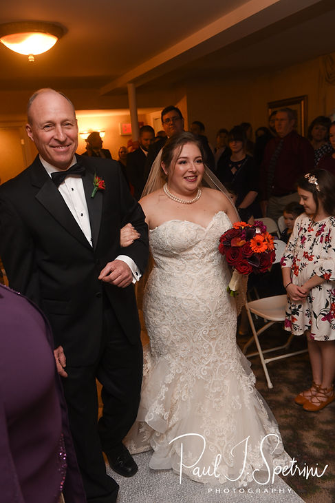 Stephanni walks down the aisle during her October 2018 wedding reception at Rachel's Lakeside in Dartmouth, Massachusetts.