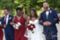 Jimmy and Saken pose for a photo with their wedding party following their July 2018 wedding ceremony at Lake Pearl in Wrentham, Massachusetts.