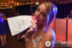 Kim eats a donut during her August 2016 wedding at Whispering Pines Conference Center in West Greenwich, Rhode Island.