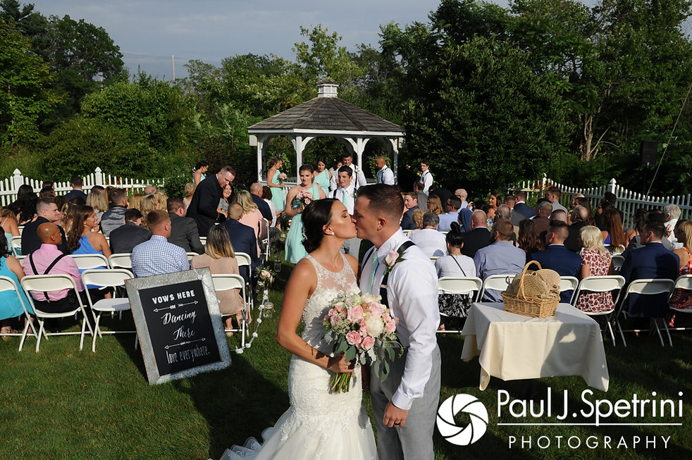 Sean and Cassie kiss following their July 2017 wedding ceremony at Rachel's Lakeside in Dartmouth, Massachusetts.