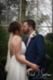 Ali and Gary kiss during their May 2018 wedding ceremony at the Roger Williams Park Botanical Center in Providence, Rhode Island.